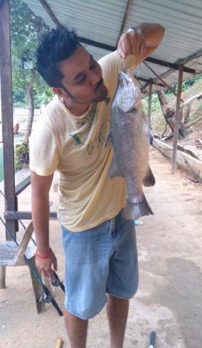 Saran with his Barramundi at the Serdang Pond