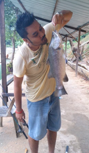 Saran with his Barramundi at the Serdang Pond