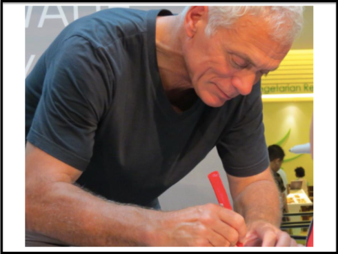 Jeremy Wade signing for the media.