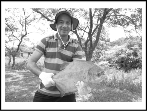 Anupam proudly holding up his Pacu