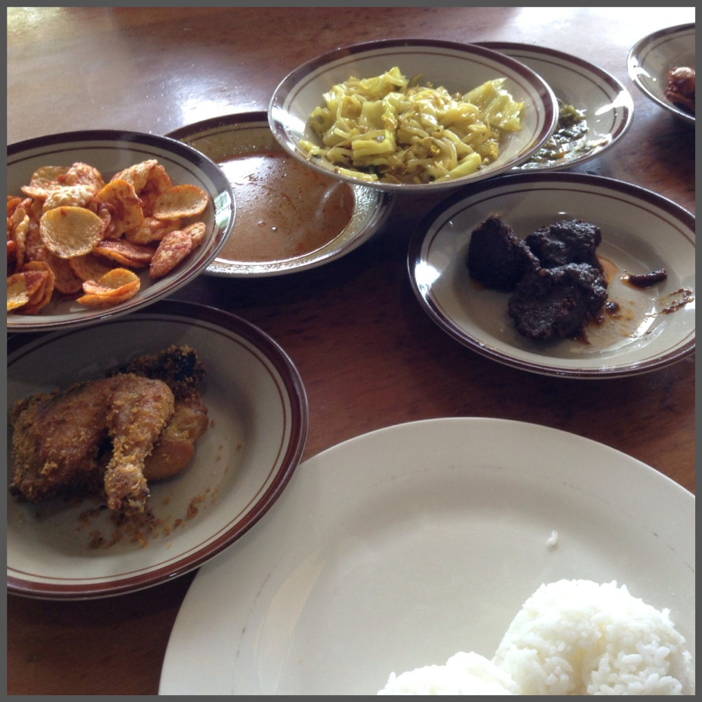 Selection of dishes with steamed rice.