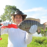 Ryan with his stunning Tilapia, caught and released safely