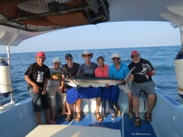 A group shot along with our beloved boatman, Sammy!